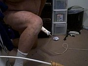 man with penis pump and dildo