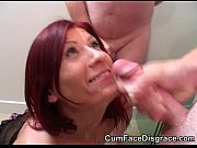 pretty redheads face takes a cum.