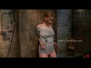 blonde immobilized on bondage device