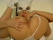 skinny babe with a mask fisting her wide cunt