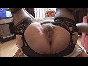 hairy busty mature lady in slip and girdle.