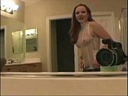 Redhead dancing and touching her pussy in bathroom - more on Omocams.com
