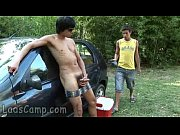 horny gay boy feeding cum to his friend outdoors