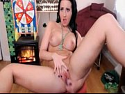 girl does webcam bating by fireplace.