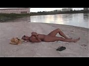 Horny, busty slut masturbating on a beach