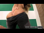jeans-clad chick peeing in her pants