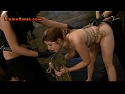 Strawberry Blonde Slave Tied To A Post