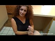 mature lady handjob in a hotel.