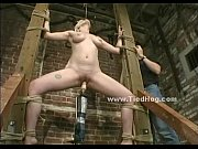 brunette locked with chains and tortured