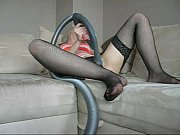 Sophie in stockings, lingerie and glasses vacuuming