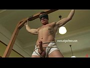 Blindfolded and naked man gets tied up and has his cock and nipples teased