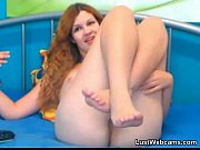 redhead cam girl plays with her.