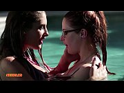 Sexy girl kissing hot friend in pool