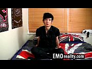 shy emo teen talks to the camera and.