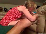 Tattooed mommy gives head her man on the sofa