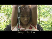 lora restrained in the woods for being spanked.