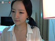 shy asian teen plays on webcam.