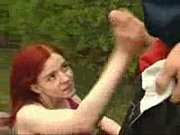 redhead in threesome in park