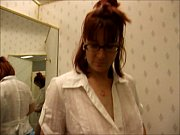 Amateur gives a blowjob in a stores dress in the dressing room