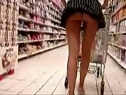 beautiful short skirt girl shops with a buttplug.