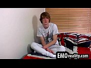 Blonde emo teen talks to the camera and then removes his clothes