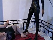 sexy domina whipping her slave