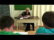 Mature teacher is fucked by two horny guys