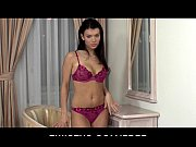 Lingerie clad brunette shows off her panties before masturbating