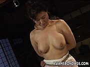 Asian babe in rope bondage sce