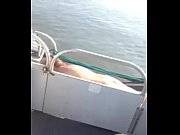 blonde MILF sun bathing Naked on pontoon boat