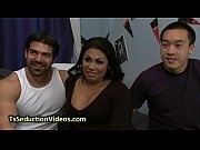 Tanned busty tranny in bdsm threesome