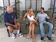 Blonde MILF babe gives a blowjob while two dudes watch