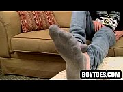 Handsome hunk plays with himself and shows his feet
