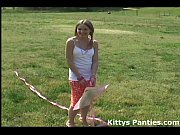 Innocent teen Kitty flying her kite