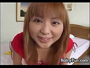 dirty asian cutie plays with her.