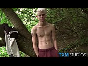 Fit and hung blonde twink Titus Snow jerking in the woods