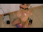 Cute girl encased in latex, with a ballgag, locked on a sybian and forced to cum