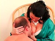 Mistress puts him in a diaper and feeds him tits