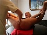 Picture Mature Slave Tied To a Table and Fisted