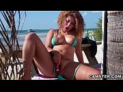 hispanic girl outdoors at the beach using her vibrator