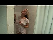 young blonde posing in shower