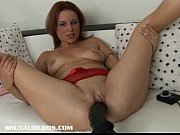 Picture Brunette is plowed by a brutal dildo machine