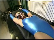 Busty slave girl plays with a dildo