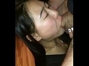 Asian beauty sucking cock