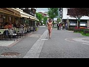 Teen shows her nude body on a public street