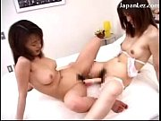 2 Asian Girls Fucking Their Pussies With A Big Double Dildo In Lesbian Scissor On The Bed