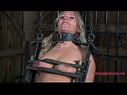 Caged babe forced to give...