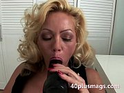 curly blonde sucking black toy