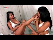 sexy brunette lesbos making out erotically.