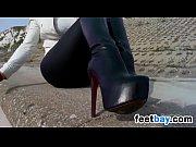 Woman In Leather Boots And Gloves Outside